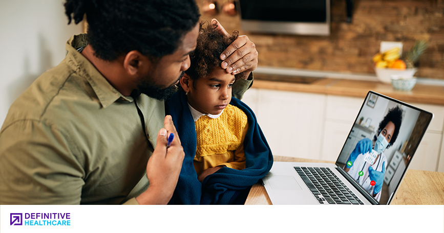Parent and child speaking with a doctor through a computer